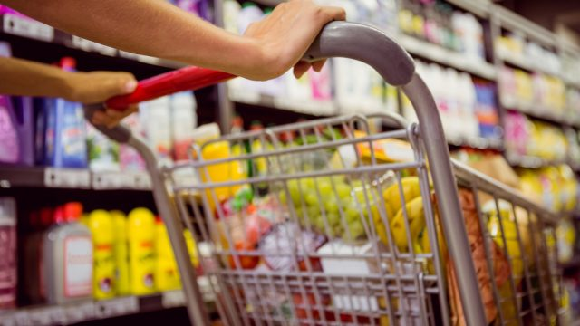 healthy foods weight loss woman pushes grocery cart in store