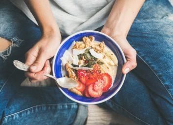 Womens healthy foods breakfast bowl strawberries grains yogurt