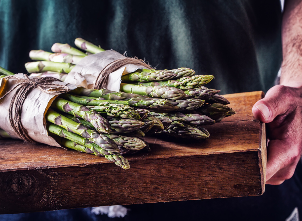 Asparagus on wooden board