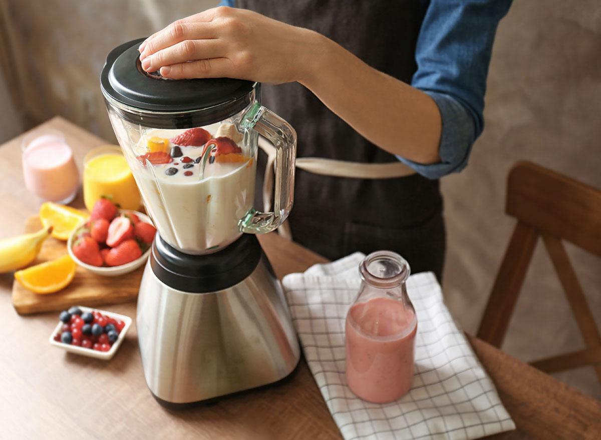 blending milk and fruit