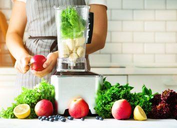 cutting apples and lettuce for blender
