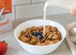 Ezekiel cereal in bowl with milk and fruit
