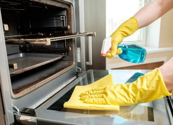 Hands cleaning oven