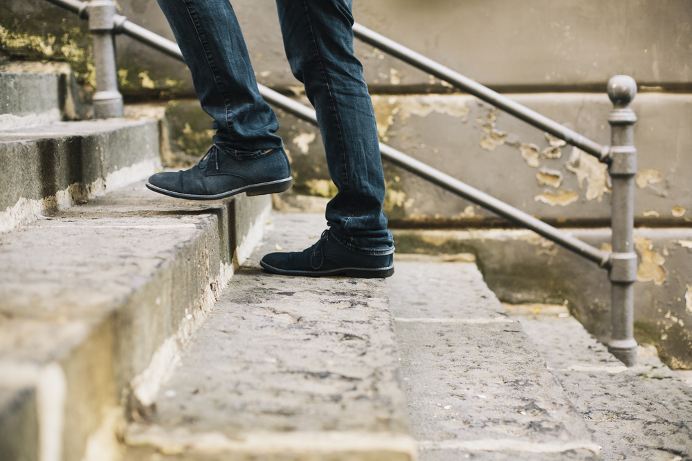 healthy habits man takes stairs outside - how to beat weight loss plateau
