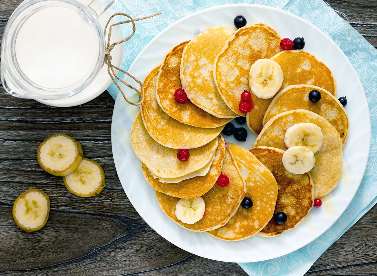 Pancakes on plate with fruit