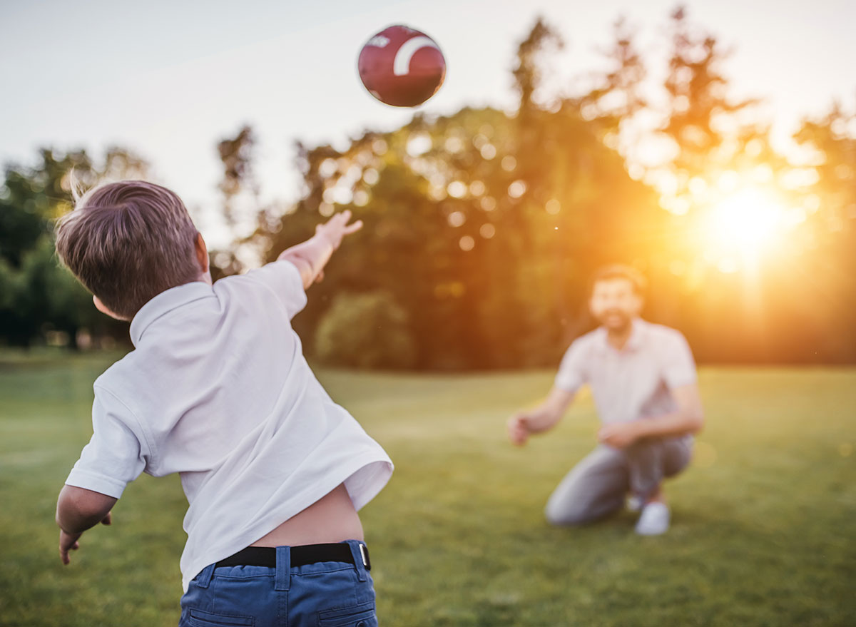 throwing a football with dad