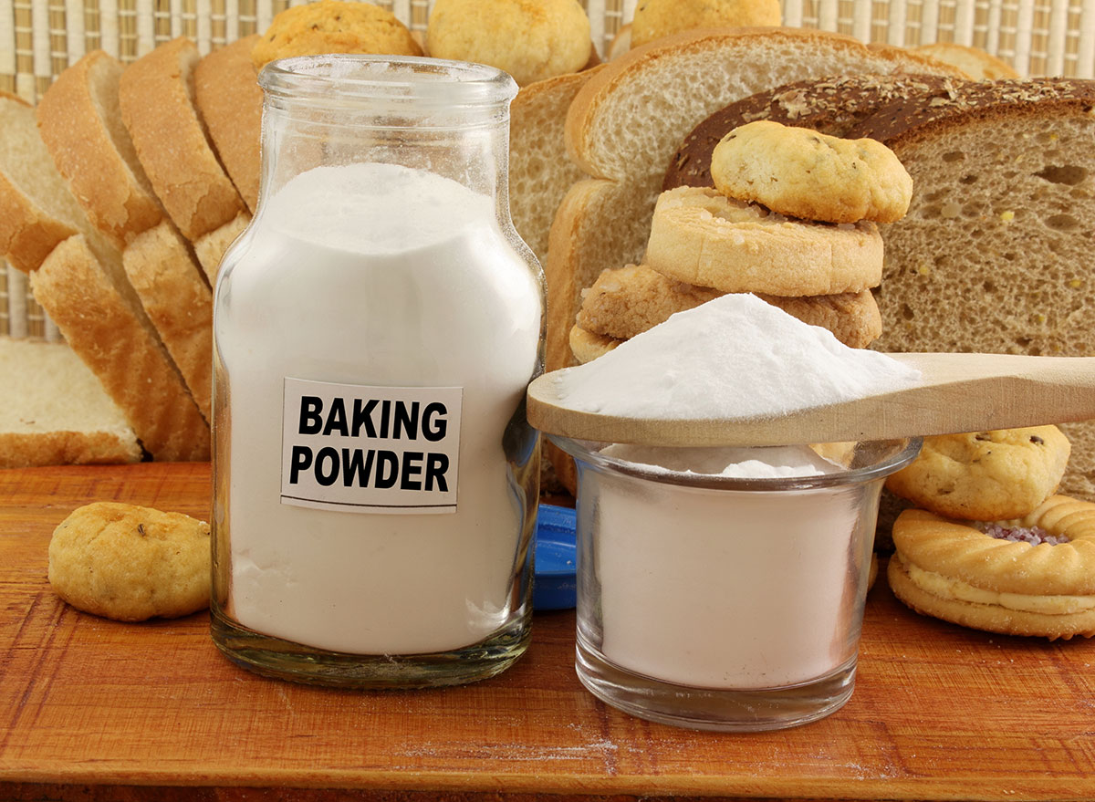 Baking powder in jar surrounded by bread products