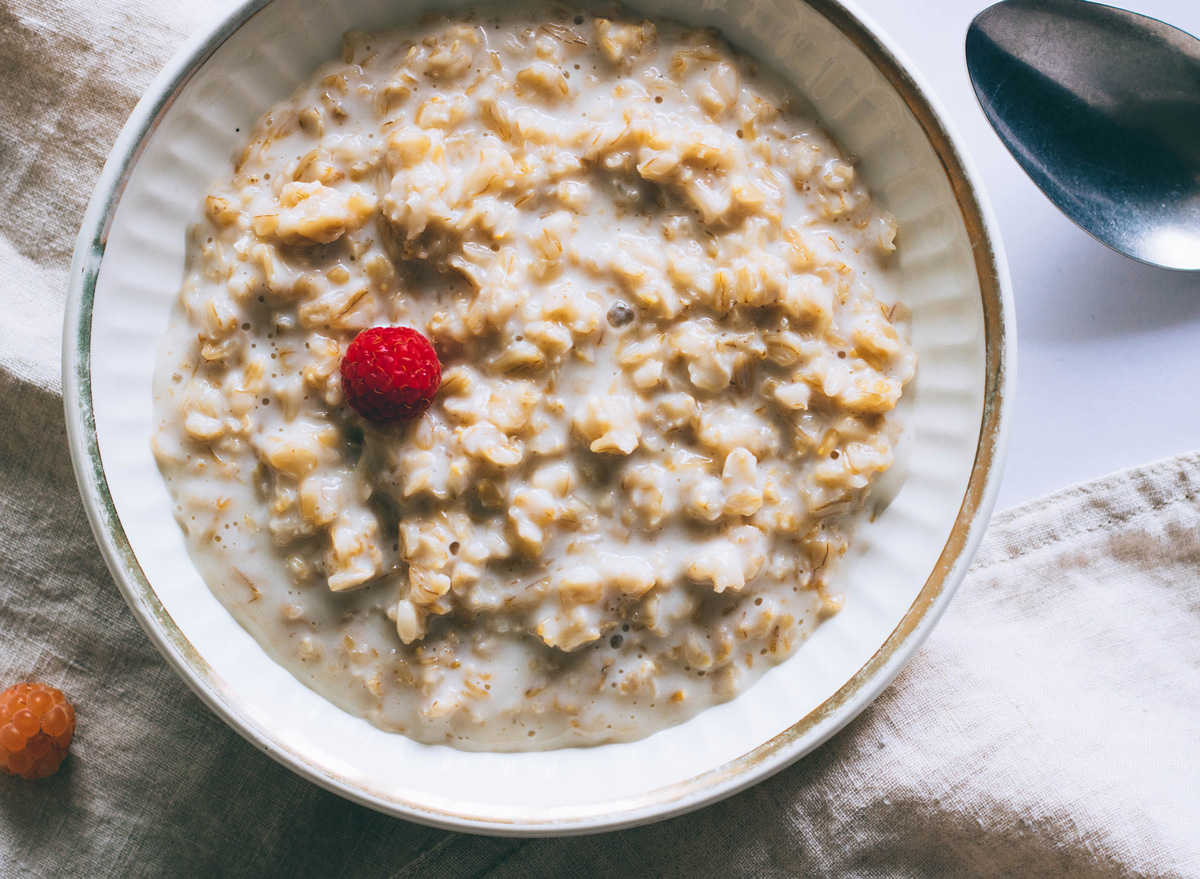 Bowl of plain oatmeal with milk for breakfast