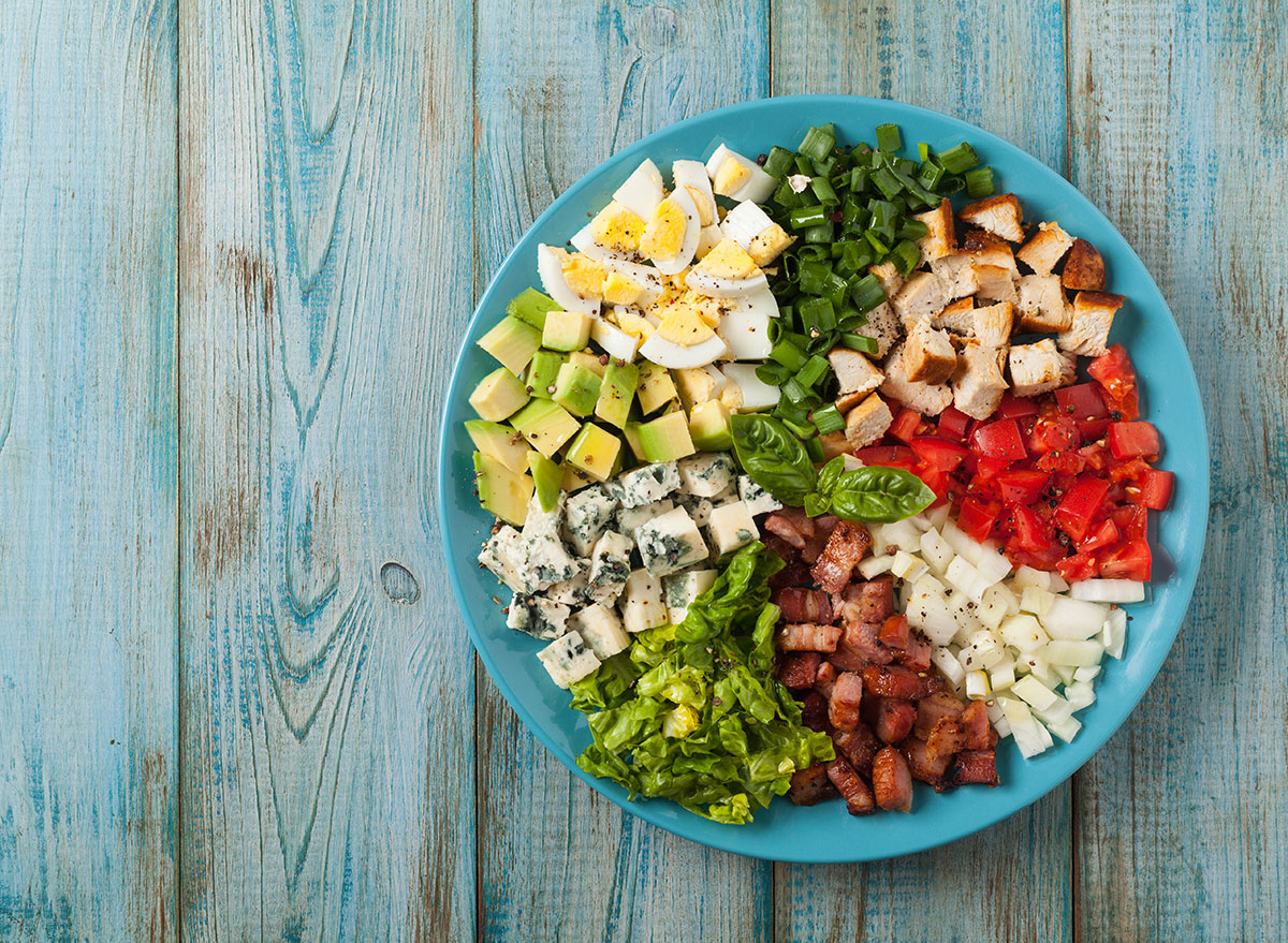 Cobb salad against blue background