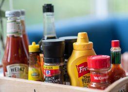 basket of condiments ketchup hot sauce mustard