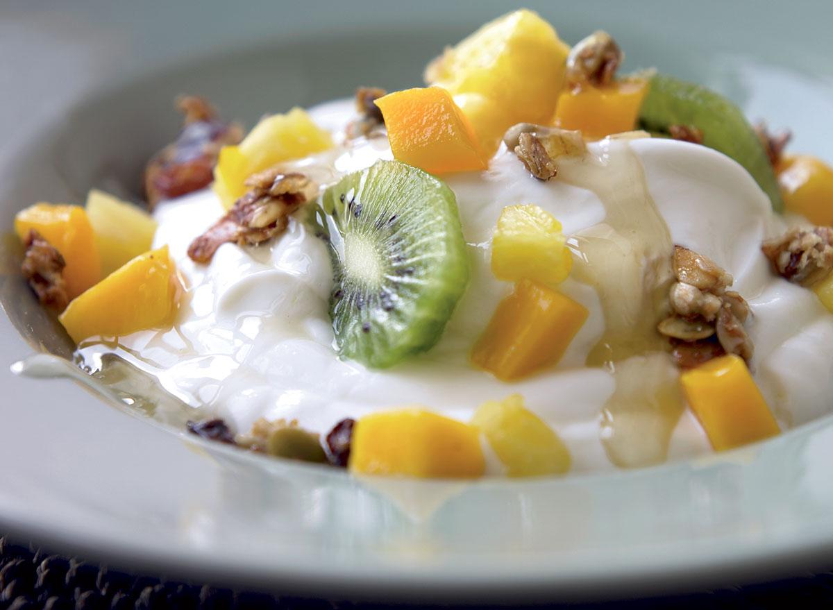 Gluten-free yogurt with pineapple kiwi mango and ginger syrup