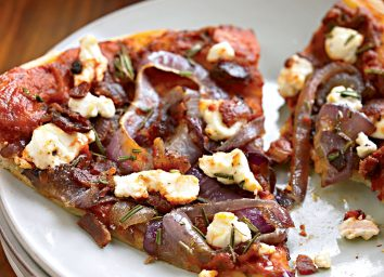 Healthy bacon pizza with caramelized onions and goat cheese