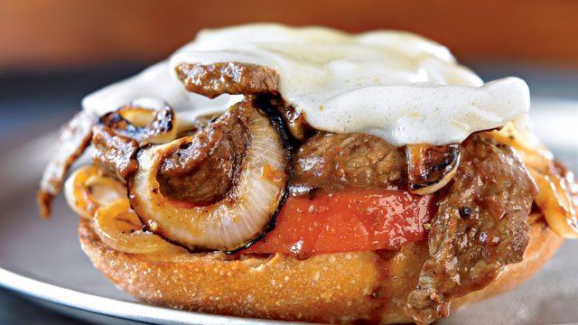 Healthy steak sandwich open-face on garlic toast