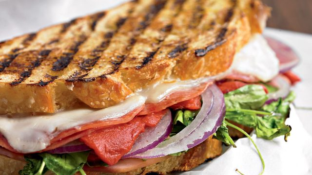 Italian panini with provolone and peppers and arugula