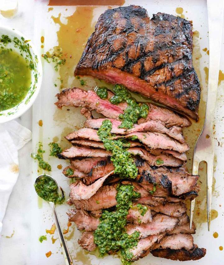 Marinated flank steak with asian chimichurri sauce