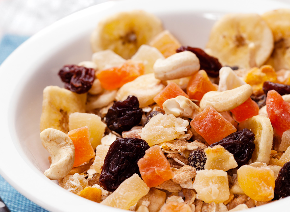 Dried fruit and nuts on top of oat oatmeal breakfast