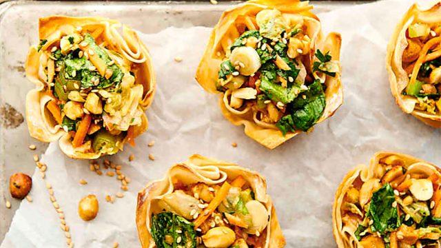 chinese chicken salad wonton cups on baking sheet