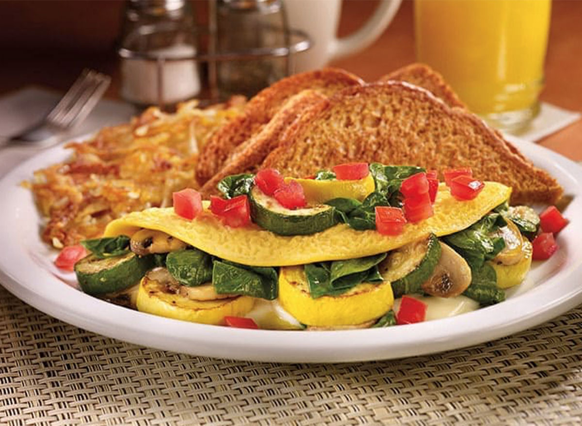 Loaded veggie omelette with hash browns