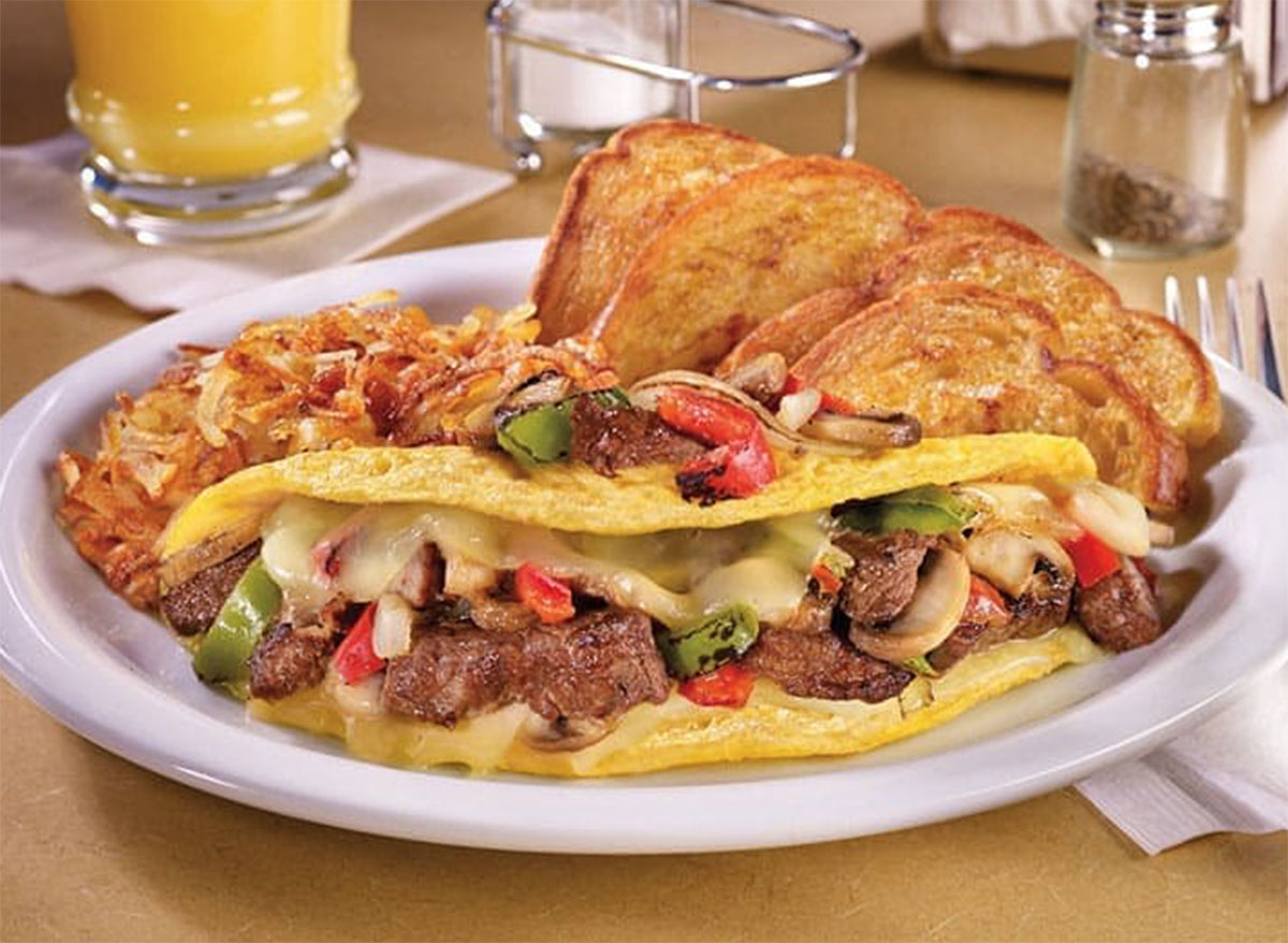 Philly cheesesteak omelette with hash browns