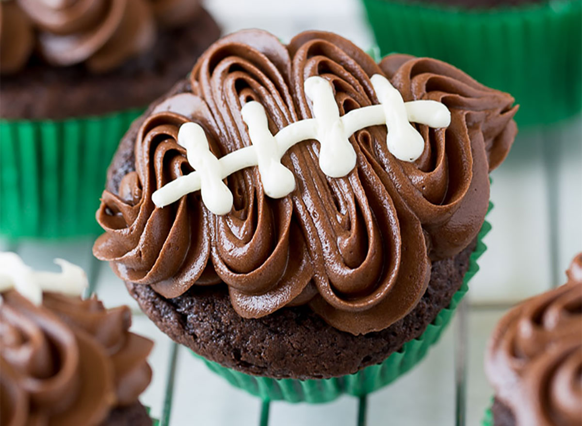football shaped cupcake with chocolate frosting
