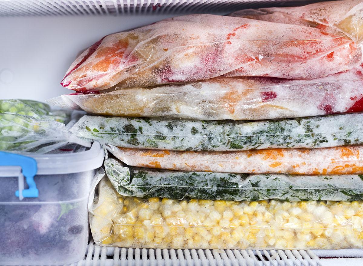 Frozen foods in bags on freezer shelf