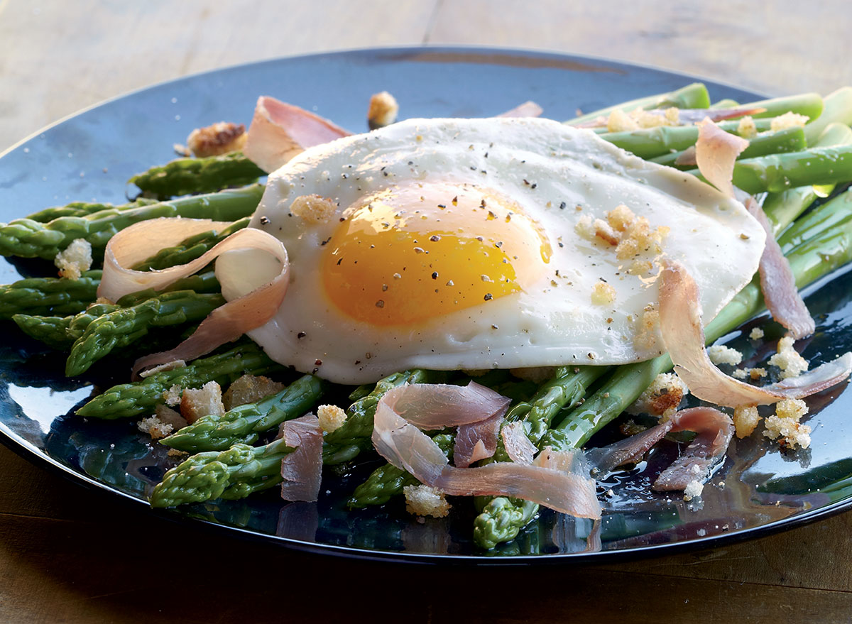 Healthy asparagus with fried eggs and prosciutto
