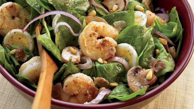Healthy spinach salad with warm bacon dressing