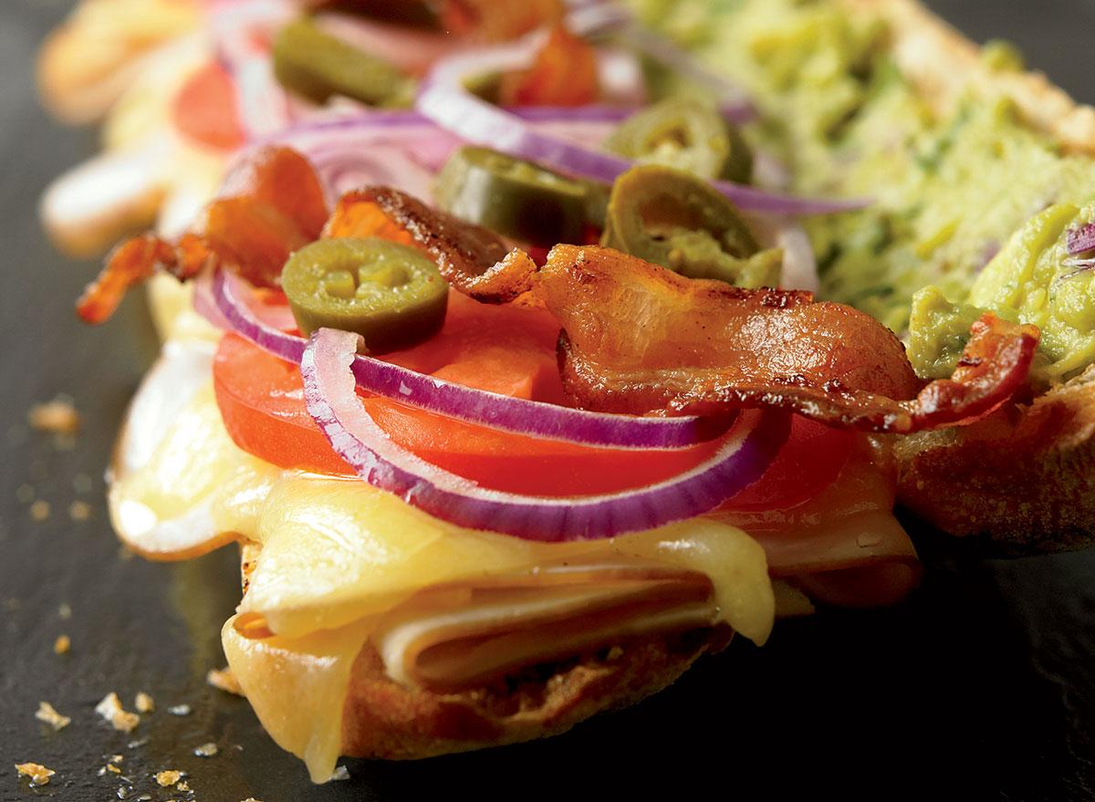 Healthy sunrise sandwich with turkey cheddar guacamole