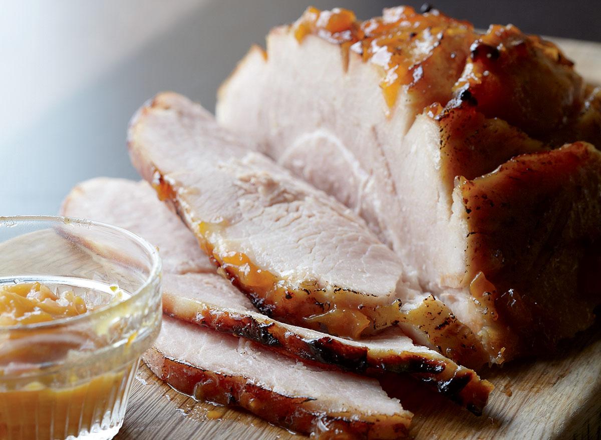 Low-calorie bourbon glazed ham with peach chutney