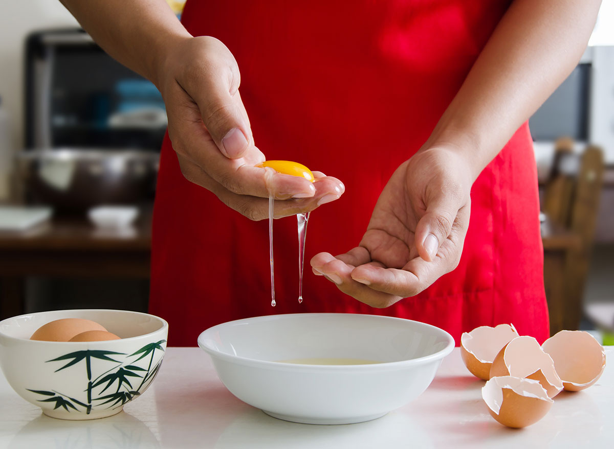 Separating egg whites with hands