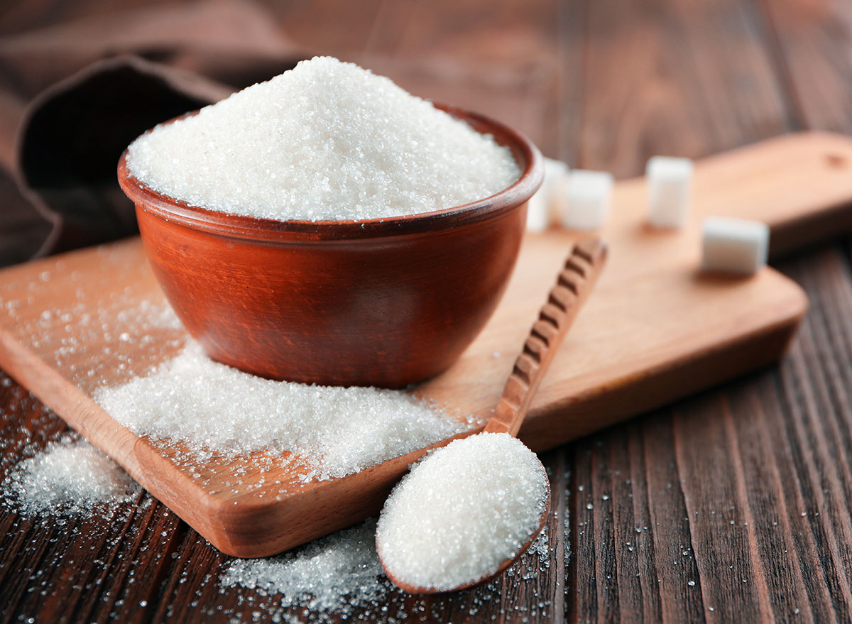 Sugar in bowl and spoon