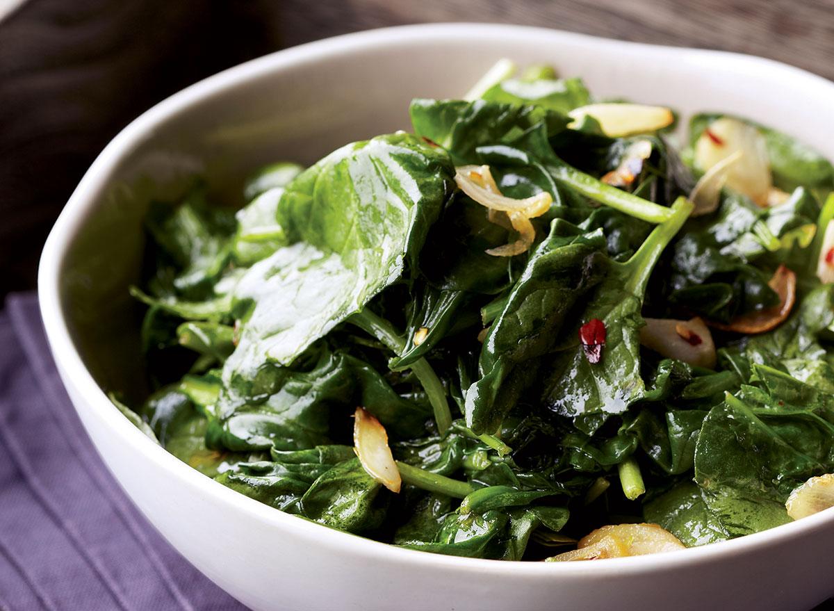 Vegan garlic lemon spinach in a bowl