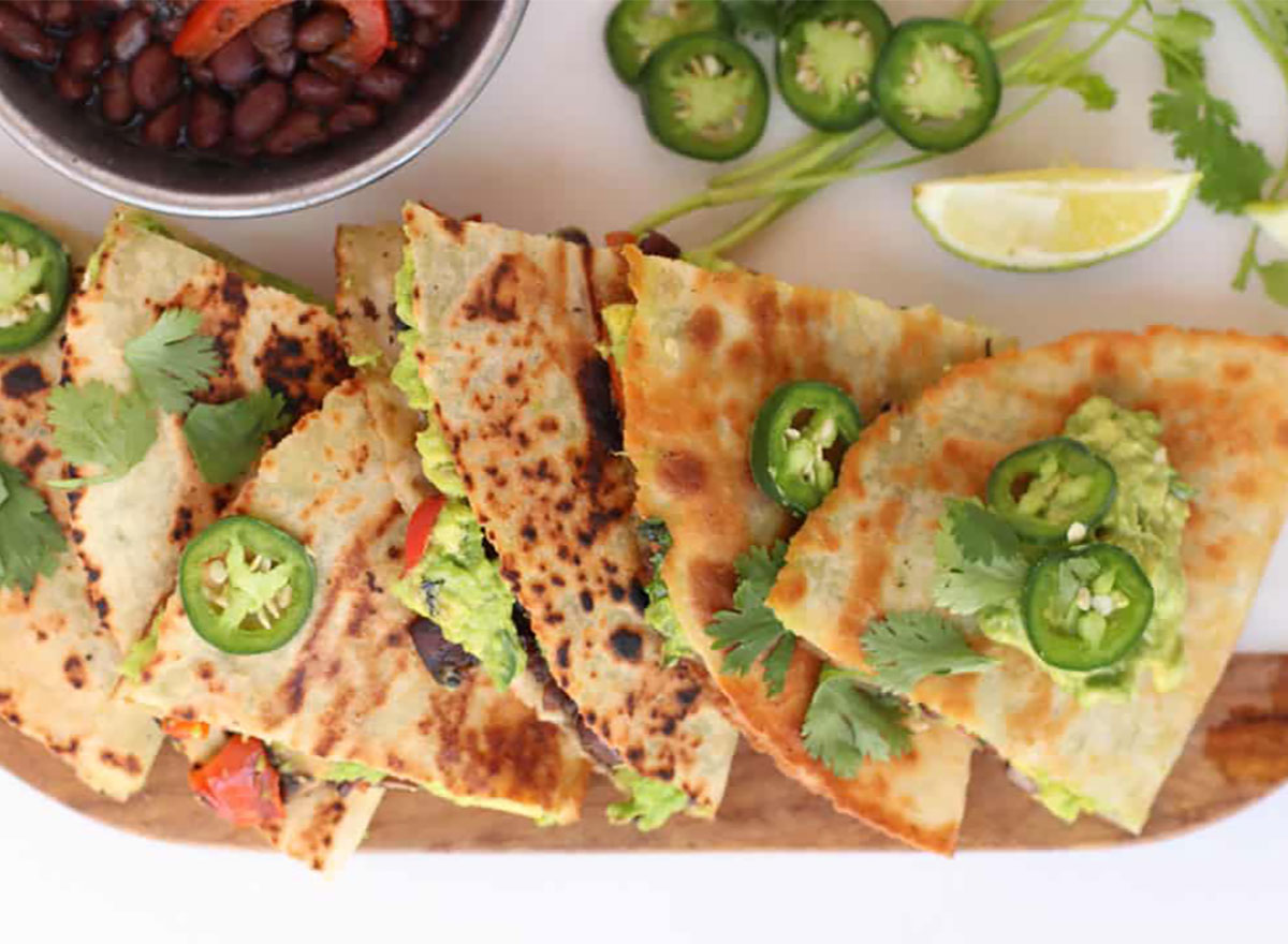 vegan quesadillas topped with jalapeno slices