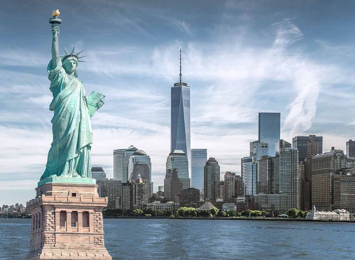 New york city skyline with statue of liberty and one world trade center