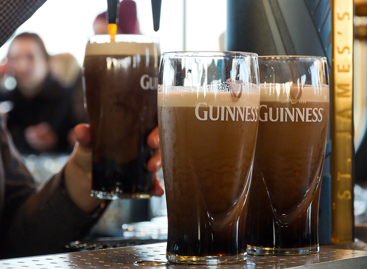 3 guinness glasses being poured