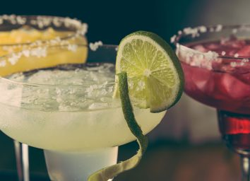 assorted margarita cocktails with salt on rim