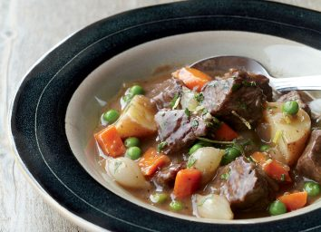 Beef stew recipe in black lined glass bowl