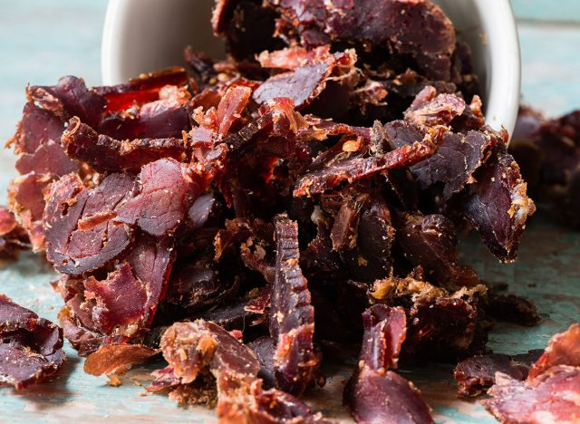 shred of biltong spilling out of white bowl