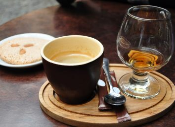 caffeinated alcohol in separate glasses on tray