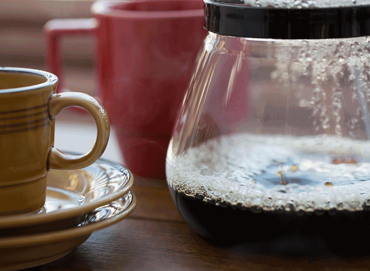 bubbling coffee pot next to mug