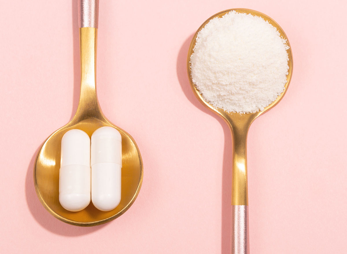 collagen pills and powder on gold spoons pink background