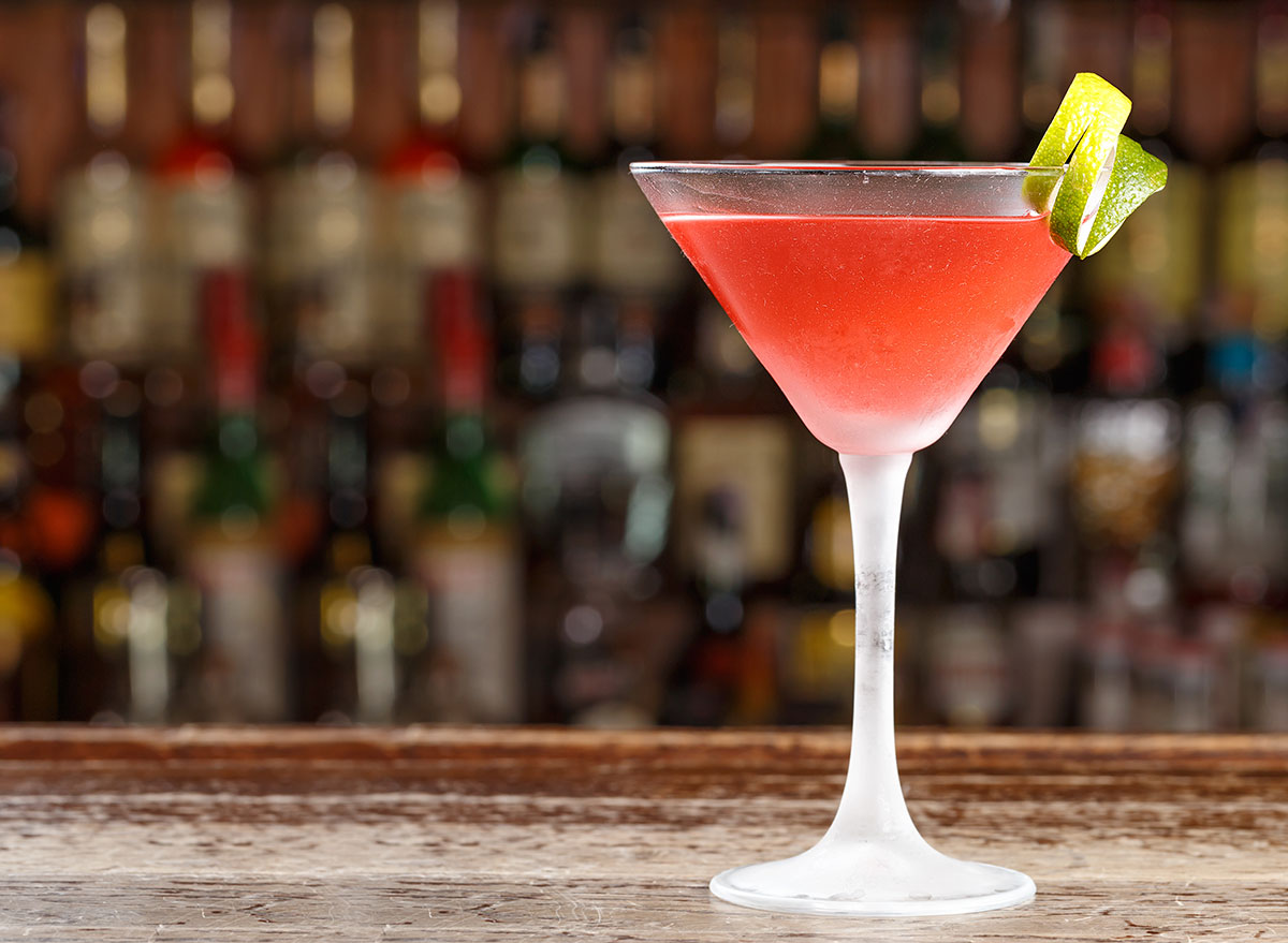 cosmopolitan cocktail on bar in tall glass