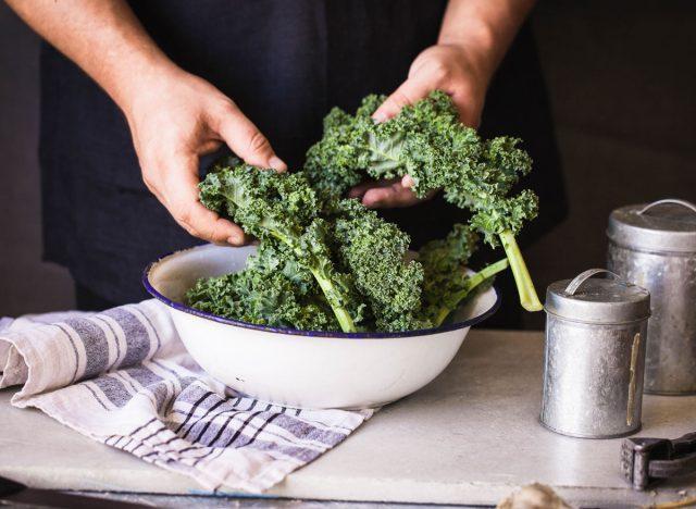 Kale dark leafy greens hand massaged in bowl