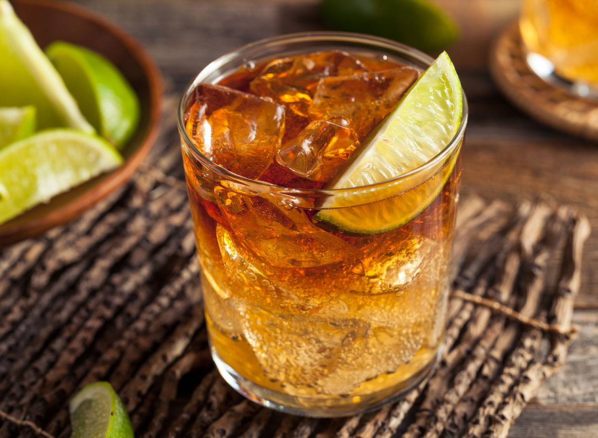 dark n stormy cocktail in glass with lime garnish