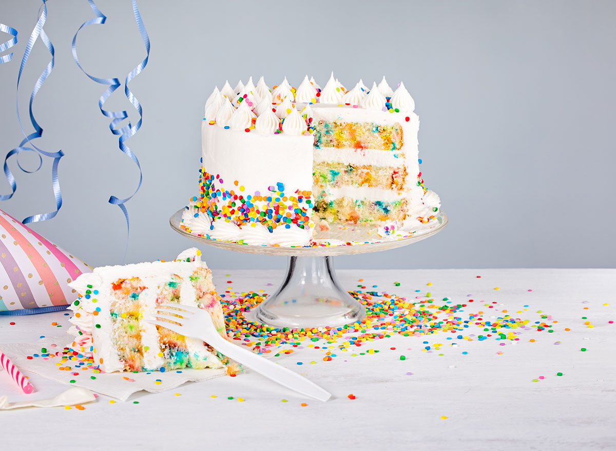 Funfetti cake with slice cut out with fork