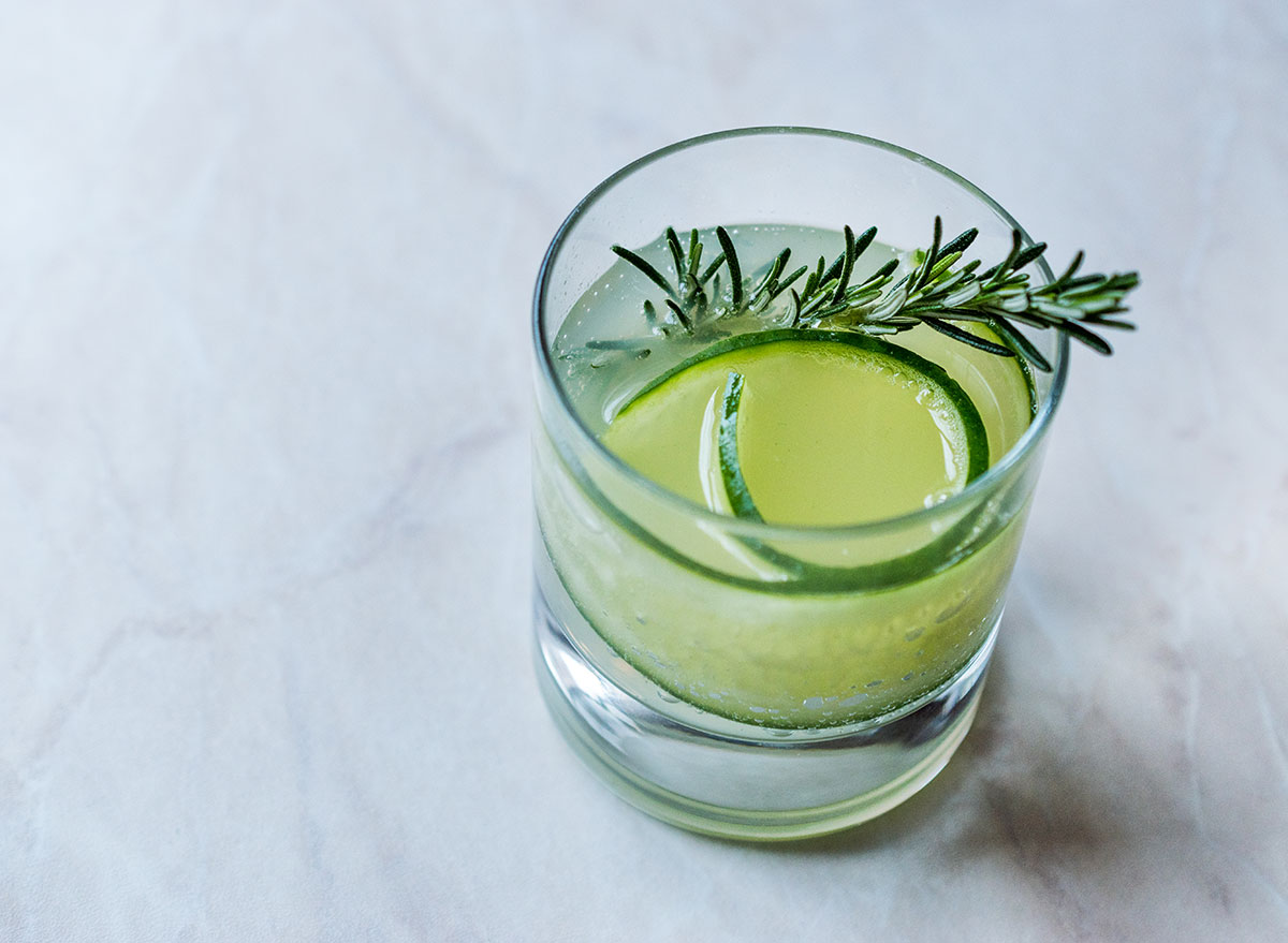gimlet cocktail in glass with cucumber garnish