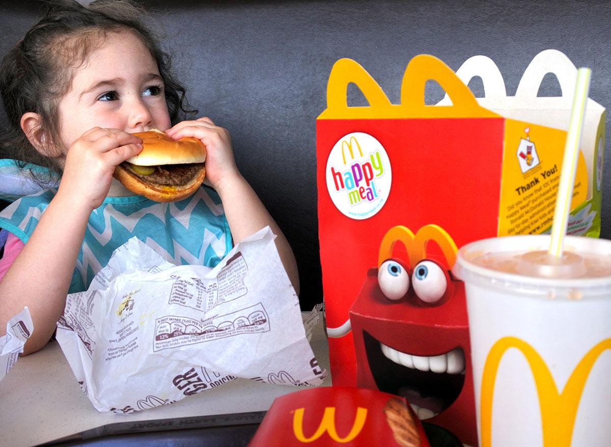 little girl eating mcdonalds