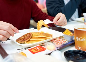 mcdonalds breakfast pancakes with sausage coffee on tray