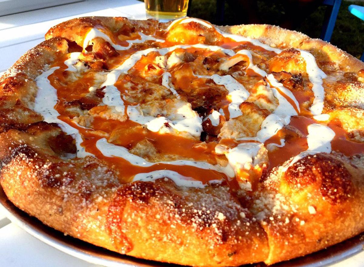 mellow mushroom buffalo chicken pizza with ranch and buffalo sauce swirl