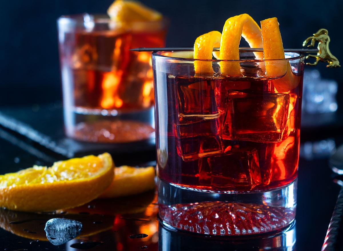 negroni cocktail glass with orange peel garnish